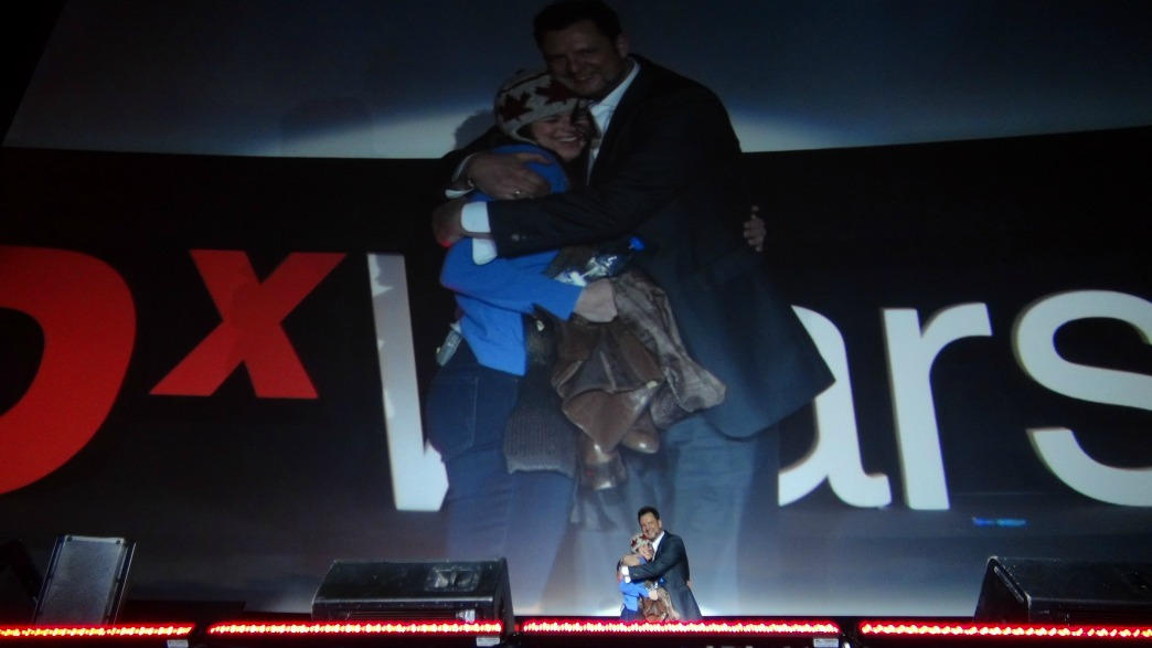 Erica Hargreave hugs Ralph Talmont at TEDx Warsaw.