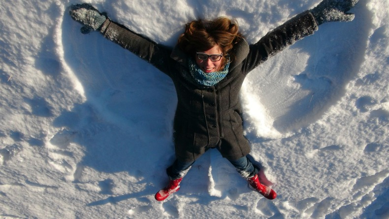 Erica Hargreave making snow angels